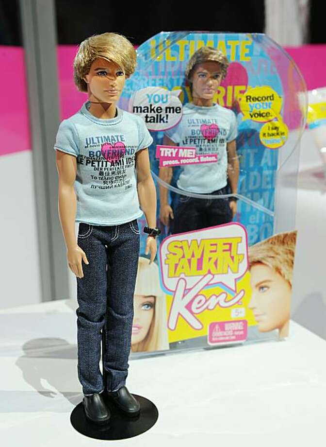 """""""Sweet Talkin. Ken"""", a Ken doll from the Barbie line in the Mattel area of the Toy Fair 2011 on February 15, 2011 at the Javits Center in New York. """"Sweet Talkin. Ken"""" is the newest release with a built-in microphone that allows girls to record up to 5 seconds of sound then play back the message in 3 different voices. His t-shirt says """"Ultimate Boyfriend"""" in 10 languages. Photo: Stan Honda, AFP/Getty Images"""