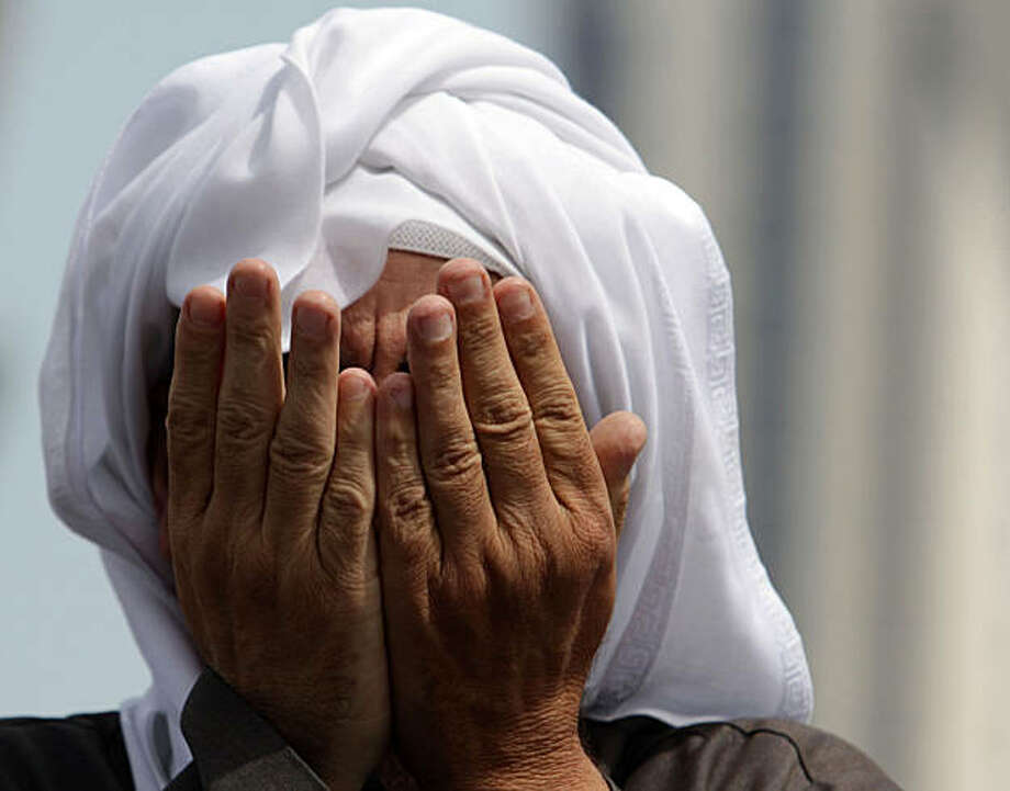 A Bahraini anti-government protester prays Monday, March 14, 2011, at Pearl roundabout in Manama, Bahrain. A Saudi-led military force crossed into Bahrain to prop up the monarchy against widening demonstrations that have sent waves of fear through Gulf states over the potential for enemy Iran to take a new foothold on their doorsteps. Photo: Hasan Jamali, AP