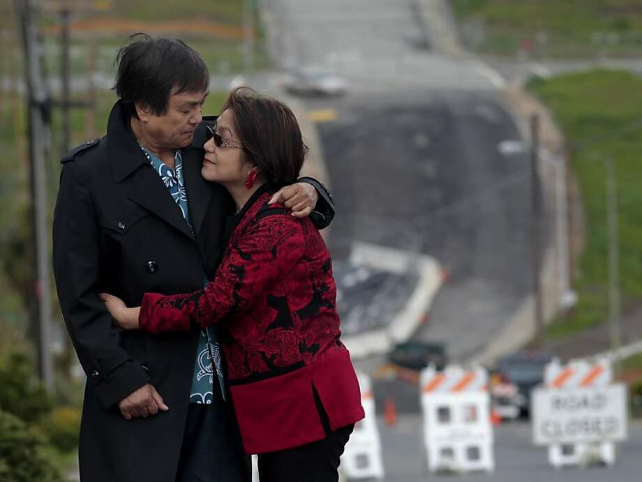 """Bill and Evelyn Palacio, stand outside their home, Wednesday March 16, 2011,  on Glenview Drive where PG&E dug and found a flawed bend in line 132, in San Bruno, Calif. When talking about the pipeline explosion, """"I heard her say our house is on fire, then the phone went dead, I thought she had perished with everything,"""" said Bill Palacio. He found out hours later that she was safe. Photo: Lacy Atkins, The Chronicle"""
