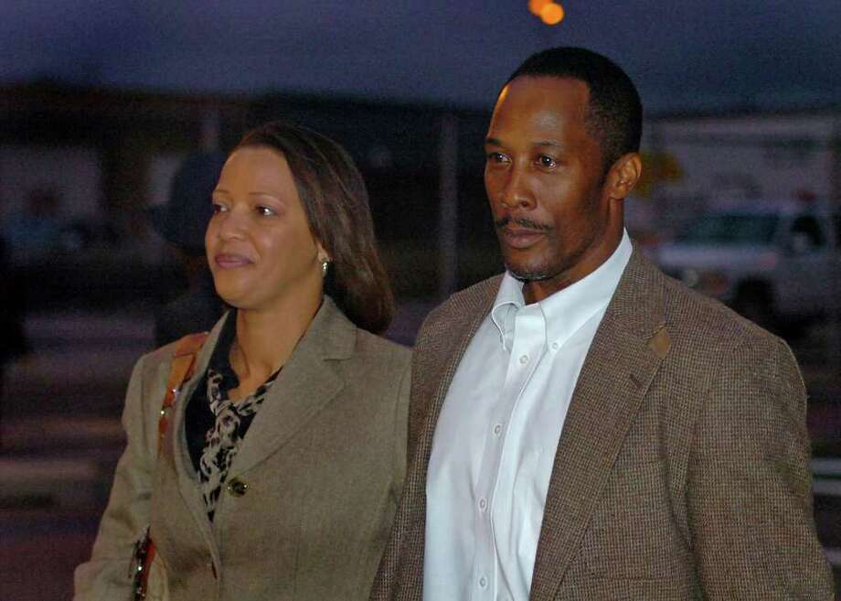 Calvin Walker and his wife Stacey Walker exit the Federal Courthouse on Monday night. Photo taken Monday, December 5, 2011 Guiseppe Barranco/The Enterprise Photo: Guiseppe Barranco, STAFF PHOTOGRAPHER / The Beaumont Enterprise