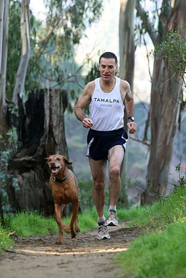 Mike Fanelli with his dog, Baci, running at Sorich Ranch Open Space Park in San Anselmo, California, on Wednesday, January 26, 2011.   Fanelli is about to run his 100,000th mile. Photo: Liz Hafalia, The Chronicle