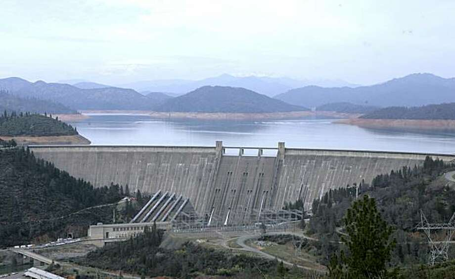 The 602-foot, concrete Shasta Dam is seen Friday,  Feb. 22, 2008.   Proposals to raise the dam between 6.5 feet to 18.5 feet, are pitting water thirsty farmers against environmentalists and Democrats in the state Legislature who oppose the project.(AP Photo/Rich Pedroncelli) Photo: Rich Pedroncelli, AP