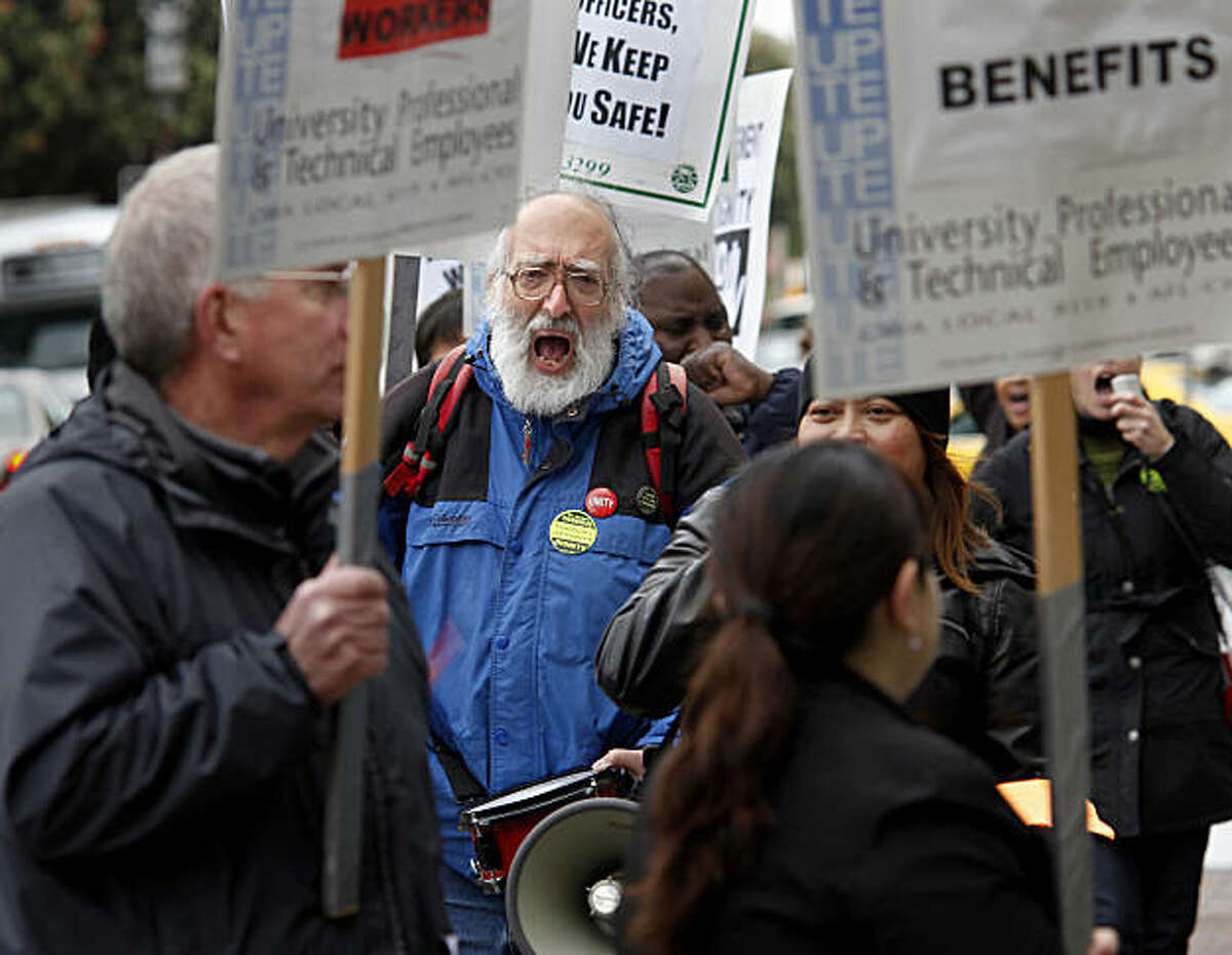 Nino Maida (center), a retired UCSF worker, shouted and played a drum as the protesters marched. Dozens of workers at University of California, San Francisco and their supporters marched in front of the medical building at 513 Parnassus Street Wednesday March 16, 2011 demanding that the UC Regents
