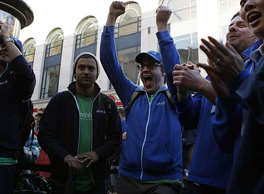 First one in line for the Ipad 2 is Joshua Leavitt (middle) from Taskrabbit who's been waiting in line since 4:00am today in front of the Apple store in Union Square in San Francisco, Calif., on Friday, March 11, 2011. Photo: Liz Hafalia, The Chronicle