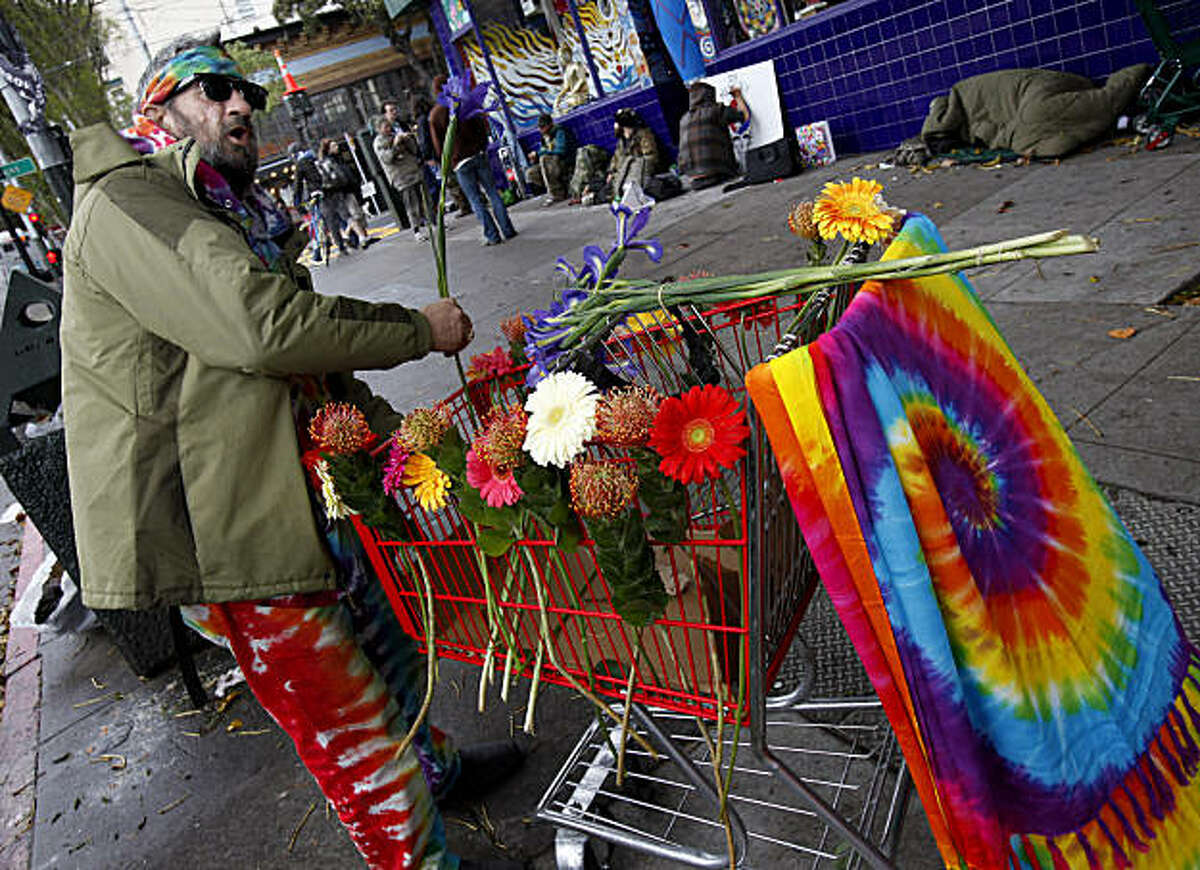 """""""Fast"""" Ed decorated a cart with flowers in memory of """"Bear"""" Stanely while others talked about his legend in the background Sunday March 13, 2011. Augustus Owsley Stanley or """"Bear"""" Stanley was remembered on the corner of Masonic and Haight Streets in San Francisco, Calif. by people who knew him and loved the Grateful Dead."""