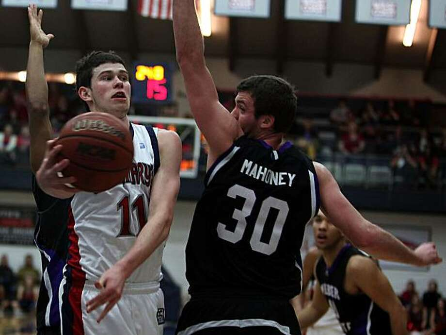 Saint Mary's College vs. Weber State in the NCCA tournament  in Moraga, Calif., as Clint Steindl passes behind Weber's Darin Mahoney during the second period on Friday, March 11, 2011. Photo: Liz Hafalia, The Chronicle