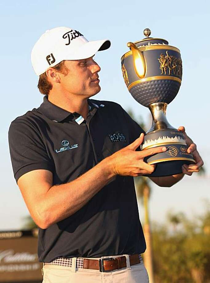 DORAL, FL - MARCH 13:  Nick Watney poses with the Gene Sarazen trophy after his two-stroke victory at the 2011 WGC- Cadillac Championship at the TPC Blue Monster at the Doral Golf Resort and Spa on March 13, 2011 in Doral, Florida. Photo: Sam Greenwood, Getty Images