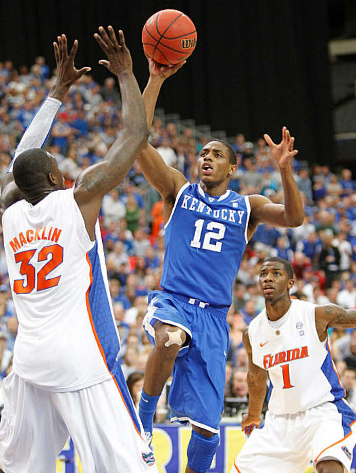 Kentucky Wildcats guard Brandon Knight (12) puts in two of his team high 17 points against Florida in the championship game of the SEC basketball tournament at the Georgia Dome in Atlanta, Georgia, on Sunday, March 13, 2011. Kentucky defeated Florida, 70-54. (Mark Cornelison/Lexington Herald-Leader/MCT) Photo: Mark Cornelison, MCT