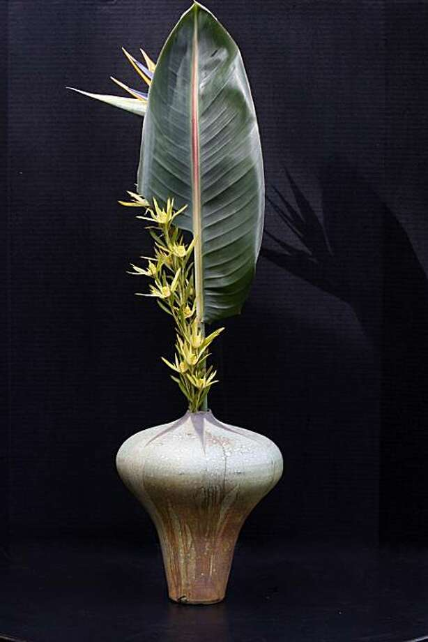 Winemaker Ron Brown used leucadenron, bird of paradise, leaf and bloom, in a ceramic vase to create his ikebana floral arrangement at the Japanese Tea Garden in San Francisco, Calif., on Tuesday, March 8, 2011. Photo: Liz Hafalia, The Chronicle