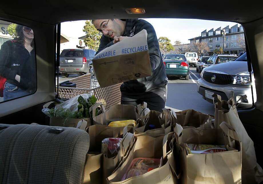 Nick Iannone loaded his groceries from the Safeway store on Market Street in San Francisco, Calif. Iannone tends to buy things on sale at Safeway to manage the family food budget. The consumer price index released Wednesday December 15, 2010 indicates grocery prices will rise significantly in 2011. Meat, poultry and dairy products are expected to rise in price the most. Photo: Brant Ward, The Chronicle