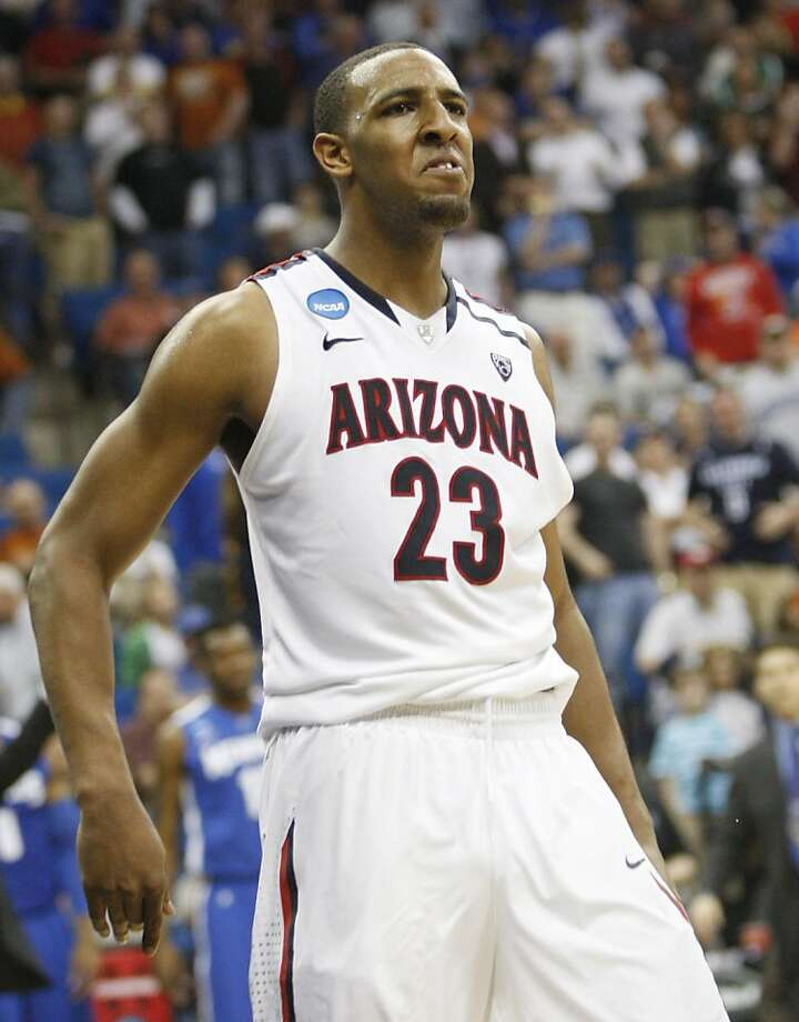 Arizona forward Derrick Williams reacts after blocking a shot by Memphis' Wesley Witherspoon in the final seconds of play at a West Regional NCAA tournament second-round college basketball game, Friday, March 18, 2011, in Tulsa, Okla. Arizona won 77-75. Photo: J. Scott Applewhite - AP, AP