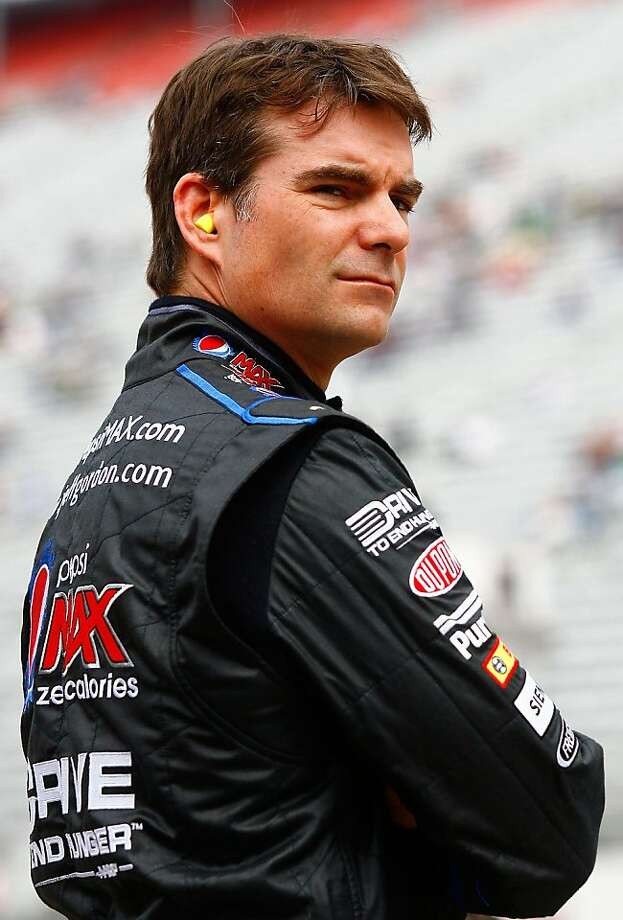 BRISTOL, TN - MARCH 18:  Jeff Gordon, driver of the #24 Pepsi Max Chevrolet, stands in the garage area during practice for the NASCAR Sprint Cup Series Jeff Byrd 500 Presented By Food City at Bristol Motor Speedway on March 18, 2011 in Bristol, Tennessee.  (Photo by Jason Smith/Getty Images for NASCAR) Photo: Jason Smith, Getty Images For NASCAR