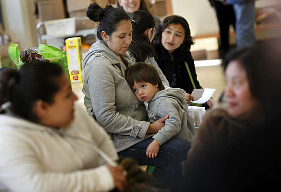 Cecelia Leon (center) held her son while she and other parents listened to a discussion about improvements at the school Monday March 7, 2011. Parental involvement at John Muir Elementary School is a huge part of the effort to turn things around academically at the San Francisco, Calif. public school. Photo: Brant Ward, The Chronicle