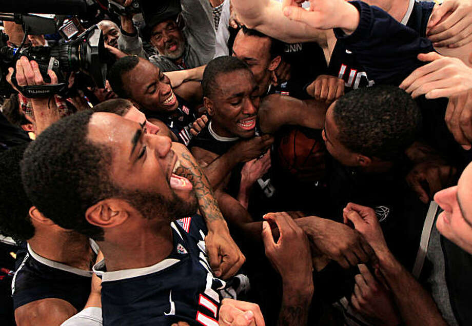 NEW YORK, NY - MARCH 12: Kemba Walker #15 of the Connecticut Huskies celebrates with teammates after defeating the Louisville Cardinals during the championship of the 2011 Big East Men's Basketball Tournament presented by American Eagle Outfitters at Madison Square Garden on March 12, 2011 in New York City. Photo: Chris Trotman, Getty Images