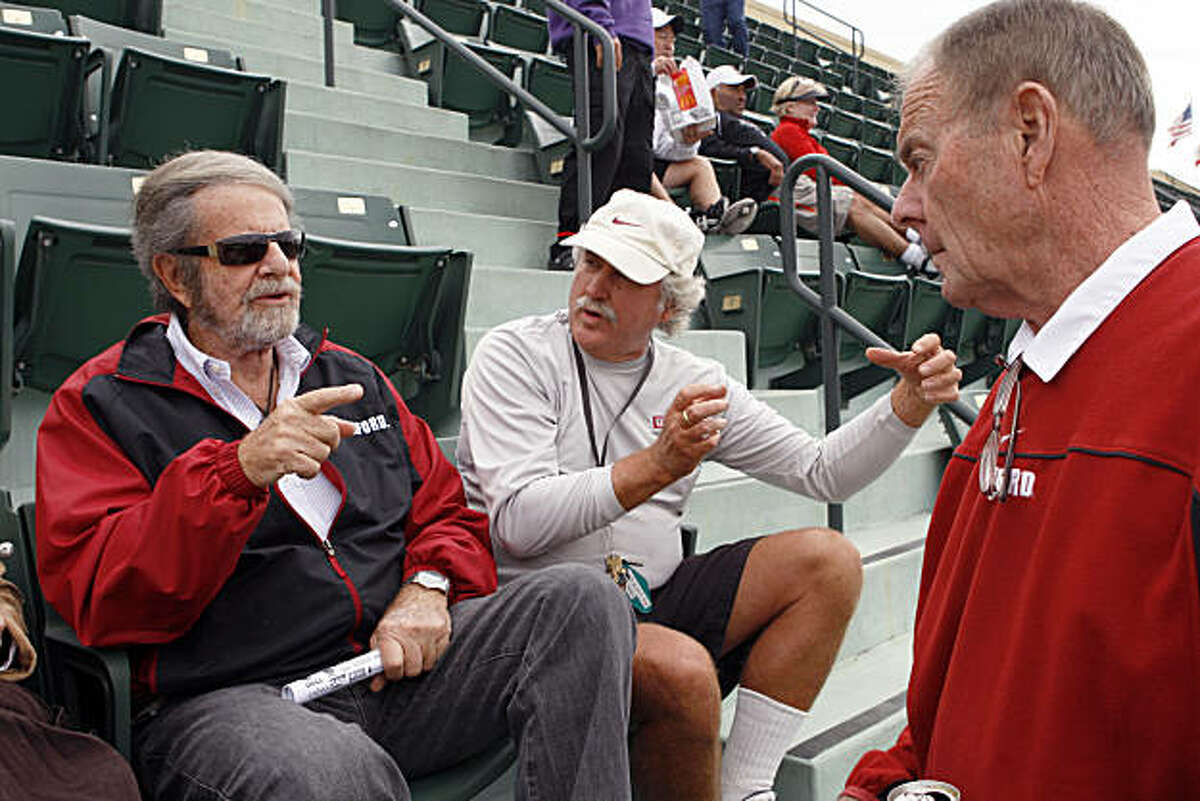 Tad Taube (left) talks with his long time tennis pro Charles Bobb and Stanford's Director of Tennis Dick Gould (right) at the Taube Family Tennis Center during a match on Stanford University's campus in Stanford Calif, on Saturday, March 5, 2011.