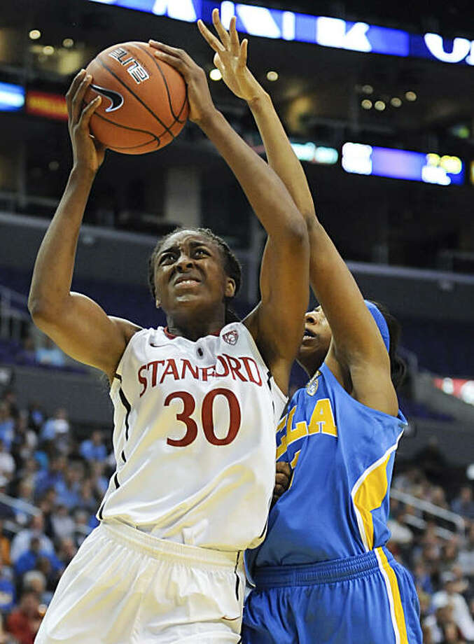 Stanford forward Nnemkadi Ogwumike (30) gets by UCLA guard/forward Atonye Nyingifa (11) for a basket during the second half of an NCAA college basketball game at the Pac-10 conference championship, Saturday, March 12, 2011, in Los Angeles. Photo: Gus Ruelas, AP