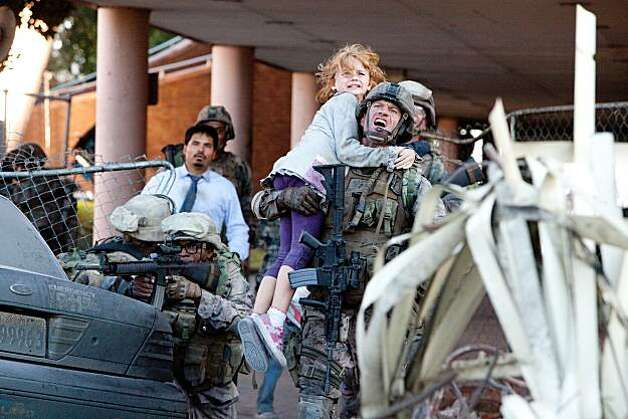"L-R, Michael Pena, Ne-Yo, Joey King and Aaron Eckhart in Columbia Pictures' ""Battle: Los Angeles."" Photo: Richard Cartwright"