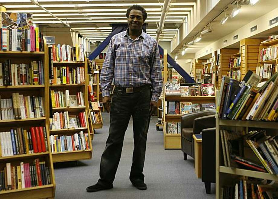 Bernard Henderson, the events coordinator at Alexander Book Co., 50 2nd st. in San Francisco, stands in the downstairs space where author readings are held. The store specializes in African-American literature and has many prominent black authors at their events. Photo: Anna Vignet, The Chronicle