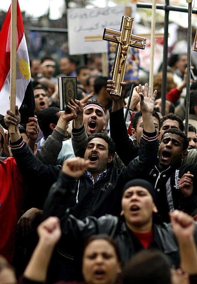 CROPPED VERSION  Egyptian Coptic Christians chant slogans during a demonstration outside the state television building in central Cairo on March 9, 2011 a day after ten people have been killed in religious clashes in the city when Christians gathered to protest the burning of a church last week. Photo: Str, AFP/Getty Images