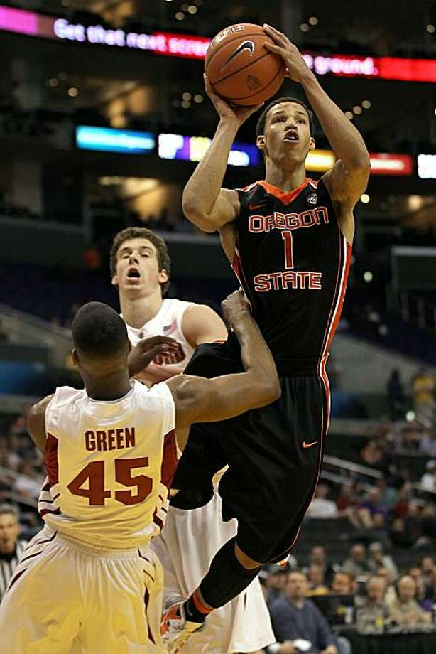 LOS ANGELES, CA - MARCH 09:  Jared Cunningham #1 of the Oregon State Beavers shoots over Jeremy Green #45 of the Stanford Cardinal in the second half in the first round of the 2011 Pacific Life Pac-10 Men's Basketball Tournament at Staples Center on March9, 2011 in Los Angeles, California. Photo: Stephen Dunn, Getty Images