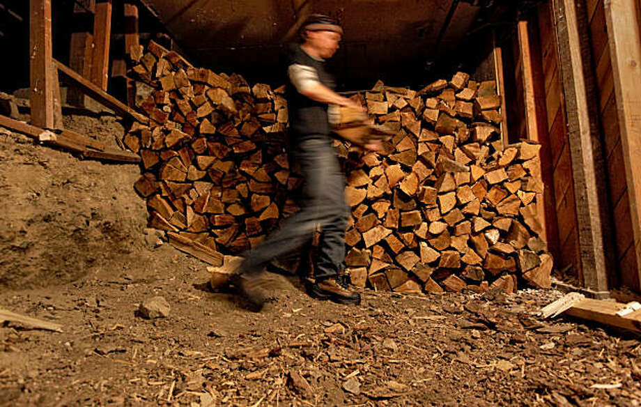 Peter Lehmkuhl, the general manager of the Sierra Club's Clair Tappaan Lodge  mountain hostel, in Norden, Ca., on Thursday March, 10, 2011. Lehmkuhl, retrieves wood from the basement storeroom of the lodge where the wood is dried and cut into small pieces to cut down on the amount of smoke released into the air. Photo: Michael Macor, The Chronicle
