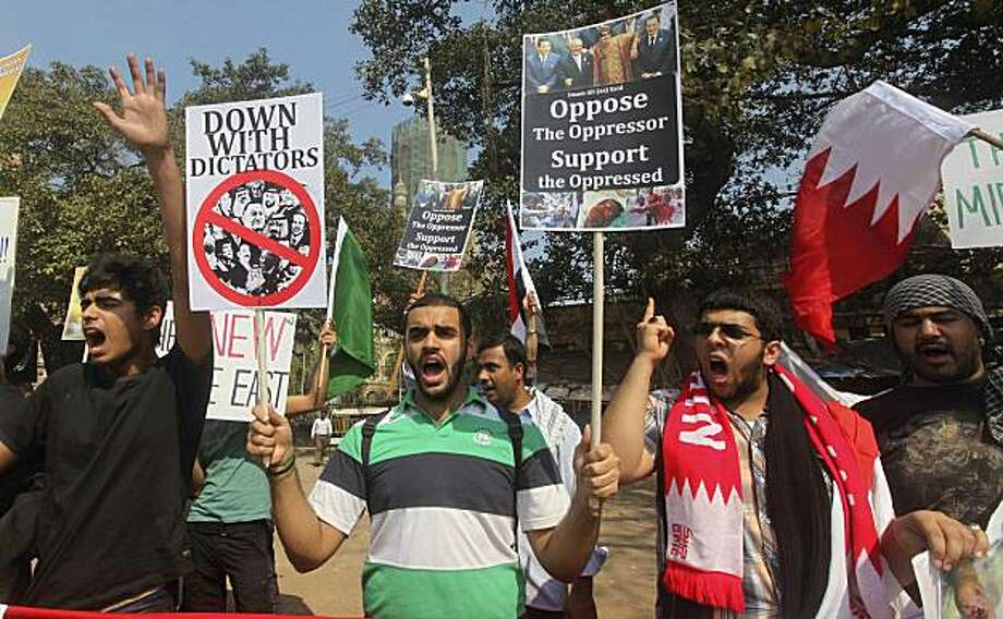 Shia Muslims hold placards condemning the crackdown against anti-government protesters across Middle East and North Africa as they stage a protest in Mumbai, India, Friday, Feb. 25, 2011. Photo: Rafiq Maqbool, AP