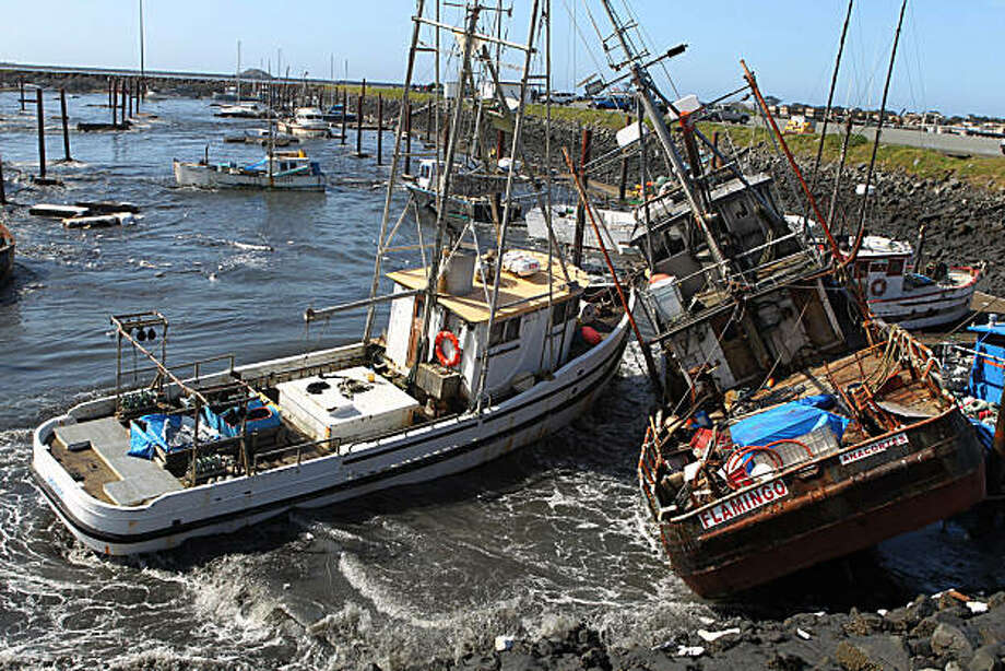 Boats collide with one another after a Tsunami surge of water swept through a boat basin in Crescent City, Calif., on Friday, March 11, 2011. The tsunami triggered by the massive earthquake in Japan rushed onto California's coast Friday morning, causing powerful surges that destroyed boat docks, sent beach-area residents throughout the state evacuating to higher ground and swept at least one person out to sea. Photo: Bryant Anderson, AP