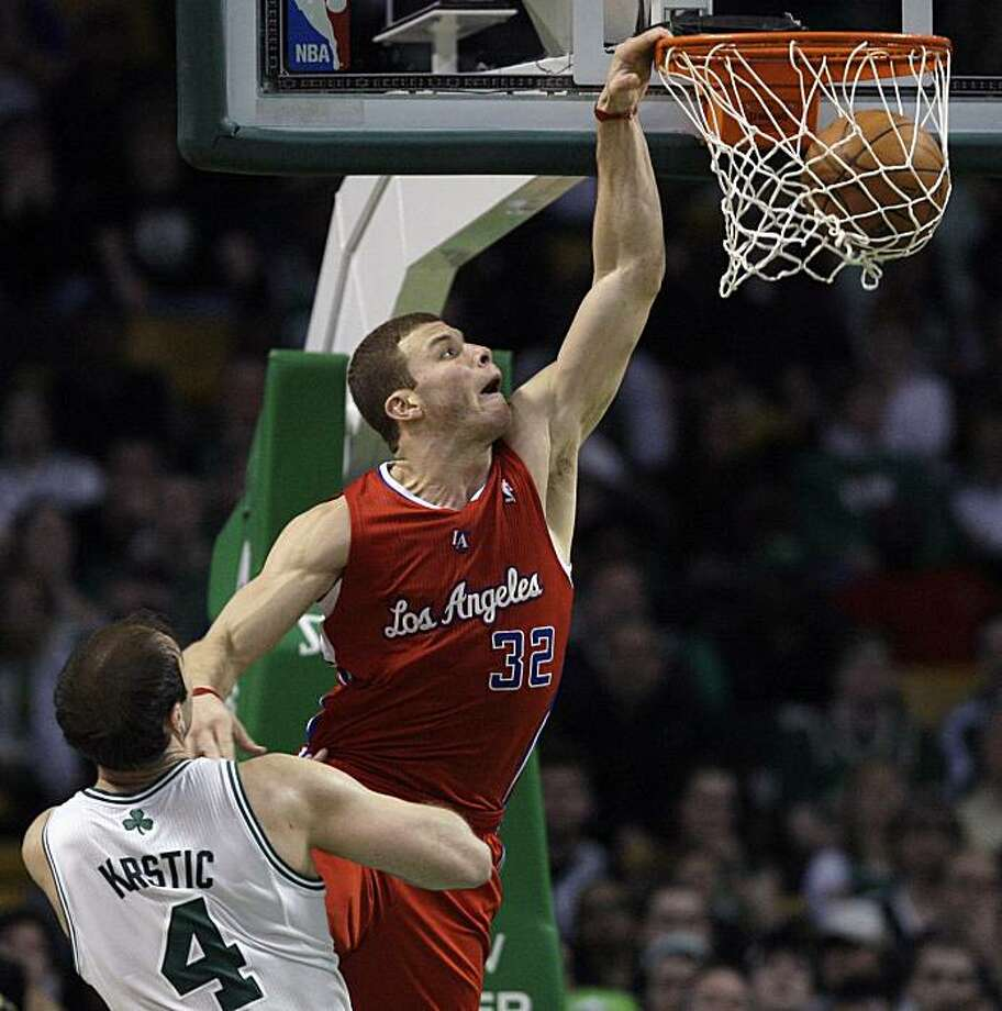 Los Angeles Clippers forward Blake Griffin (32) dunks in front of Boston Celtics center Nenad Krstic (4), of Serbia, during the second half of an NBA basketball game in Boston on Wednesday, March 9, 2011. The Clippers won 108-103. Photo: Elise Amendola, AP