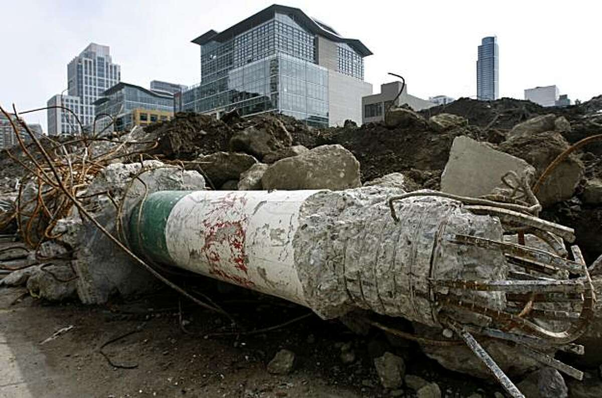 A support column from the old transit terminal garage sits in the rubble while work continues to pave the way for the new Transbay Transit Terminal in San Francisco, Calif., on Wednesday, March 9, 2011. The column will be used as a figure's arm for a new sculpture by artist Tim Hawkinson using debris from the original terminal.