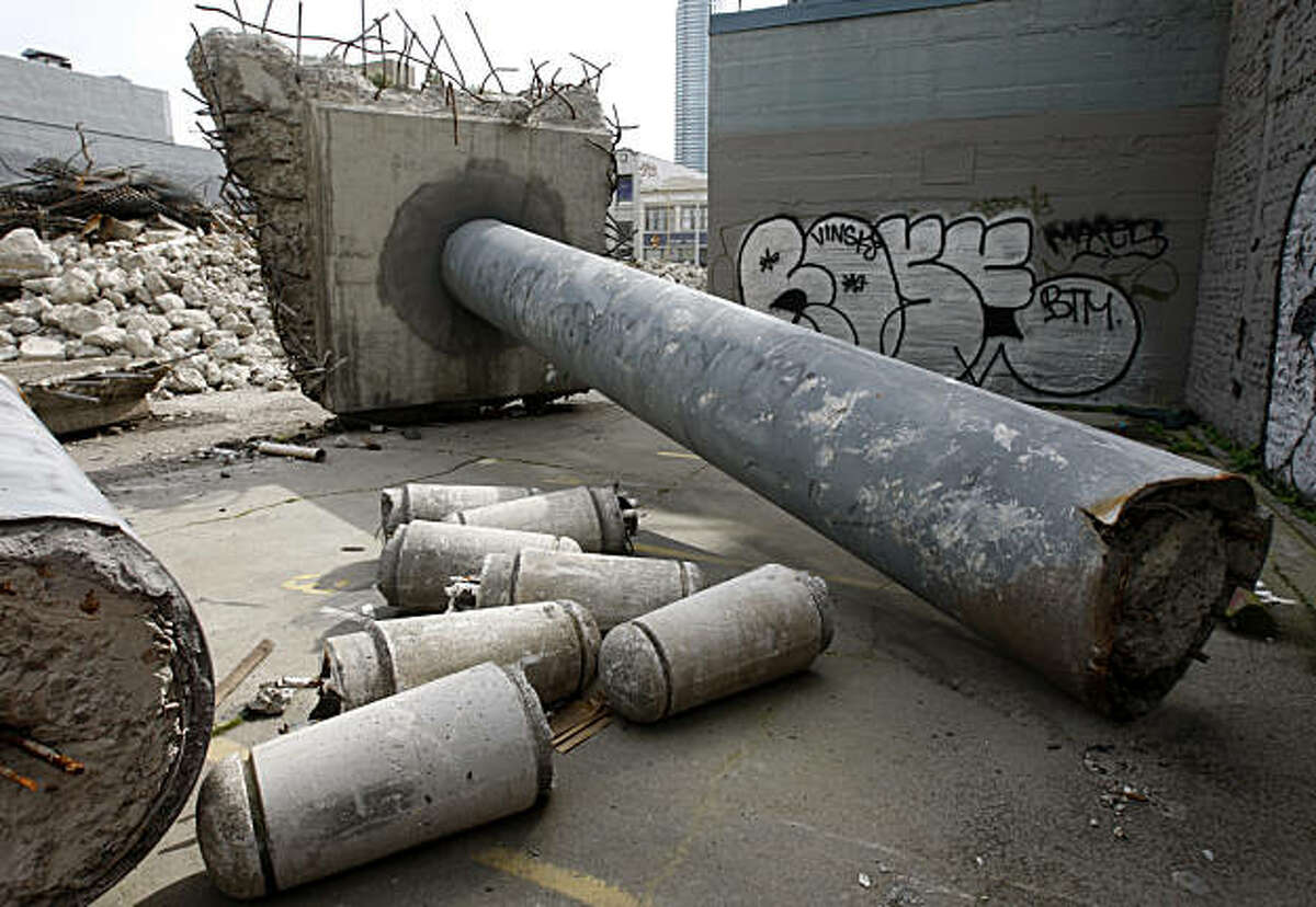Debris from the original Transbay Transit Terminal is set aside as demolition work continues to pave the way for the transit hub in San Francisco, Calif., on Wednesday, March 9, 2011. The chunks of concrete will be used as toes and an arm on a sculpture of a human figure by artist Tim Hawkinson using rubble from the original terminal.