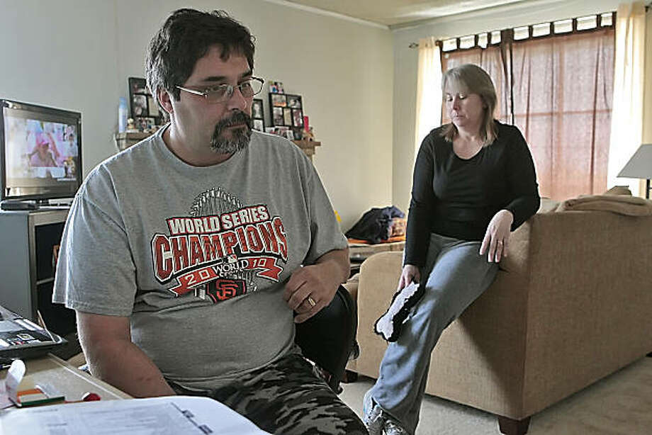 "Bob and Tina Pellegrini sit in their rented home, Tuesday March 8, 2011, in San Bruno, Calif.  They lost their home at 1701 Claremont, in the PG&E pipeline explosion and are hoping to break ground with their building plans next month. "" This place is ok, but it's not home,"" says Bob Pellegrini. Photo: Lacy Atkins, The Chronicle"