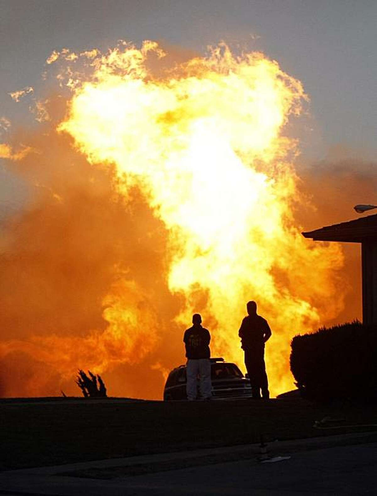Homes burn in a neighborhood off of Sneath Lane after an explosion, Sept. 9, 2010, in San Bruno, Calif.