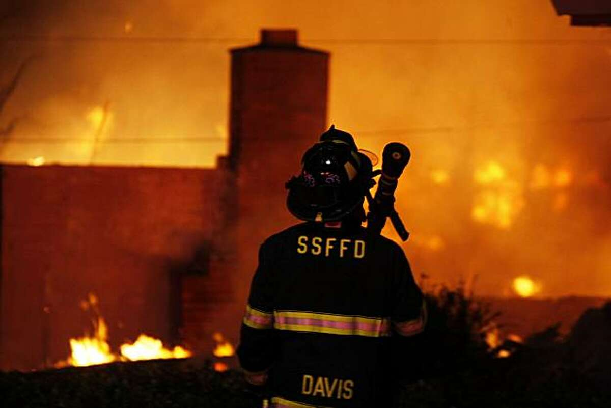 A San Francisco Fire fighter waits for water as he joins other departments from Daily City and San Bruno to fight a massive fire caused by an explosion in a San Bruno neighborhood Thursday, Sept. 9, 2010.