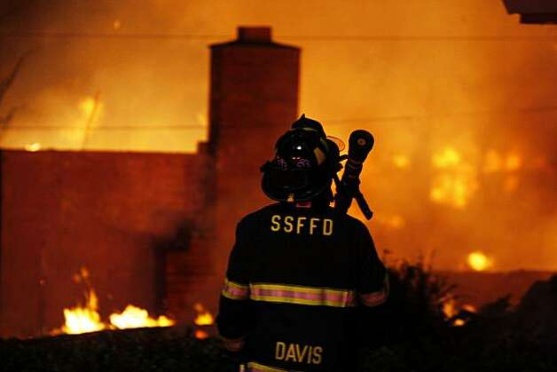 A San Francisco Fire fighter waits for water as he joins other departments from Daily City and San Bruno to fight a massive fire caused by an explosion in a San Bruno neighborhood Thursday, Sept. 9, 2010. Photo: Lance Iversen, The Chronicle