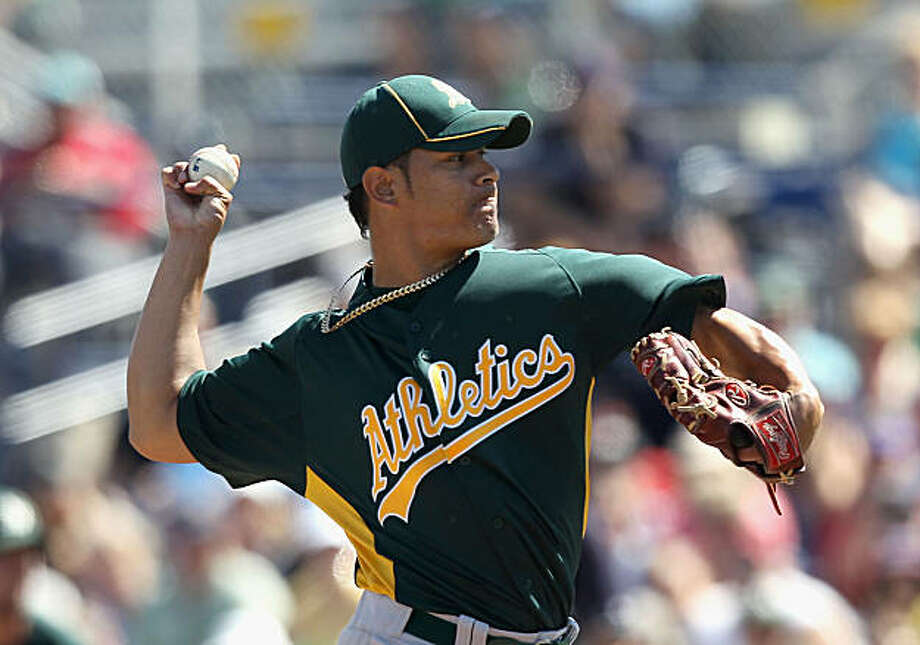 PEORIA, AZ - MARCH 12:  Starting pitcher Guillermo Moscoso #74 of the Oakland Athletics pitches against the Seattle Mariners during the spring training game at Peoria Stadium on March 12, 2011 in Peoria, Arizona. Photo: Christian Petersen, Getty Images