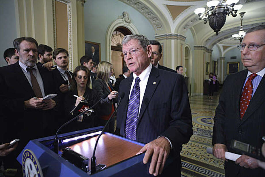 Sen. James Inhofe, R-Okla., at microphone, joined by Senate Minority Leader Mitch McConnell of Ky., right, and Sen. John Barrasso, R-Wyo., center, talks to reporters about federal regulation of greenhouse gases and soaring gas prices, Tuesday, March 15, 2011, on Capitol Hill in Washington. Photo: Stf, AP