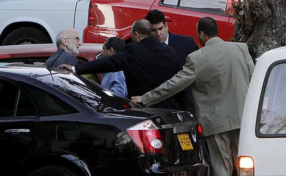 FILE - In this file photo taken March 5, 2011, U.S. government contractor Alan Gross, left, is surrounded by security forces as he arrives for his trial in Havana, Cuba. Gross, a 61-year-old Maryland native, was arrested in December 2009 and charged withundermining Cuba's government by bringing communications equipment onto the island illegally. State-run media say a Cuban court has found U.S. contractor guilty of crimes against the state and sentenced him to 15 years in prison. Photo: Franklin Reyes, Associated Press