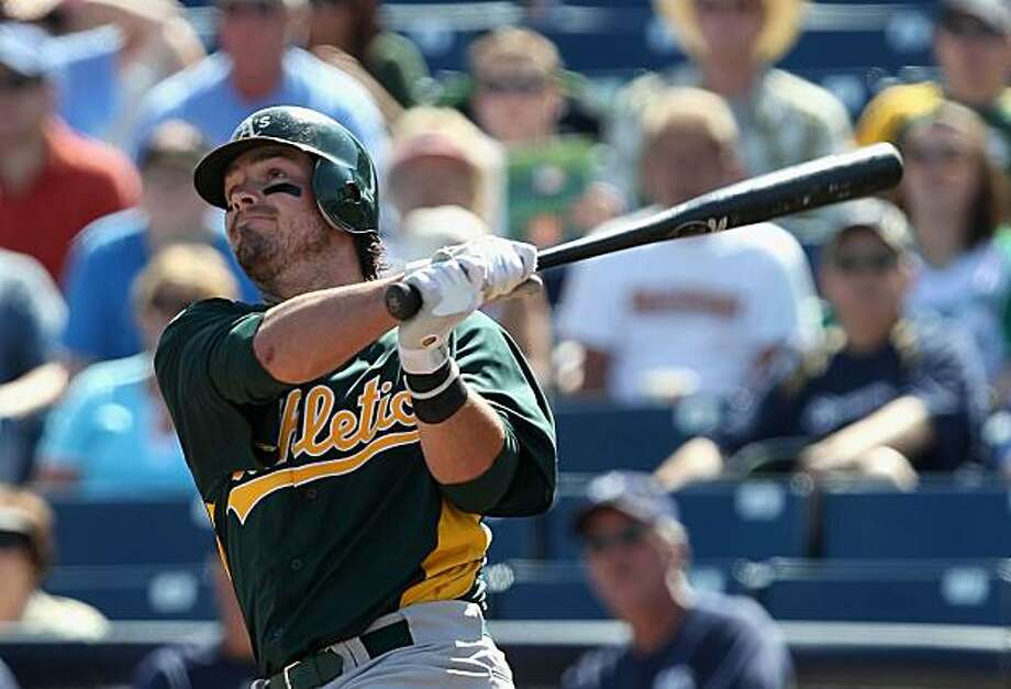 PHOENIX, AZ - MARCH 03:  Andy LaRoche #21 of the Oakland Athletics hits a solo home run against the Milwaukee Brewers during the second inning of the spring training game at Maryvale Baseball Park on March 3, 2011 in Phoenix, Arizona. Photo: Christian Petersen, Getty Images