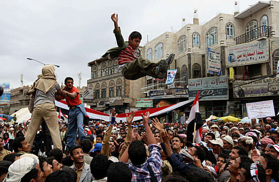Yemeni protesters throw a boy in air as they demonstrate against the regime of President Ali Abdullah Saleh in Sanaa on March 7, 2011 after the embattled leader refused to resign by the end of the year, a day after the president, who has ruled the impoverished, deeply tribal nation since 1978, dismissed opposition calls for his resignation by the end of the year and vowed to stay on until 2013. Photo: Ahmad Gharabli, AFP/Getty Images