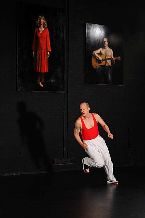 Photos by Paula Court    Sarah Michaelson dance Copy in Devotion   Performer Jim Fletcher  Paintings by TM Davy Photo: Paula Court