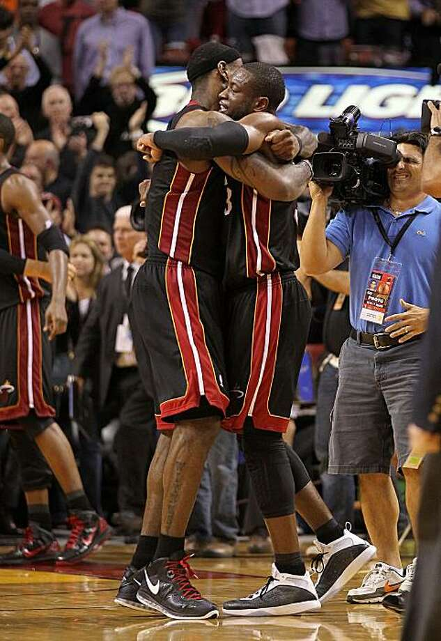 MIAMI, FL - MARCH 10:  Dwyane Wade #3 and LeBron James #6 of the Miami Heat hug after winning a game against  the Los Angeles Lakers at American Airlines Arena on March 10, 2011 in Miami, Florida. NOTE TO USER: User expressly acknowledges and agrees that,by downloading and/or using this Photograph, User is consenting to the terms and conditions of the Getty Images License Agreement. Photo: Mike Ehrmann, Getty Images