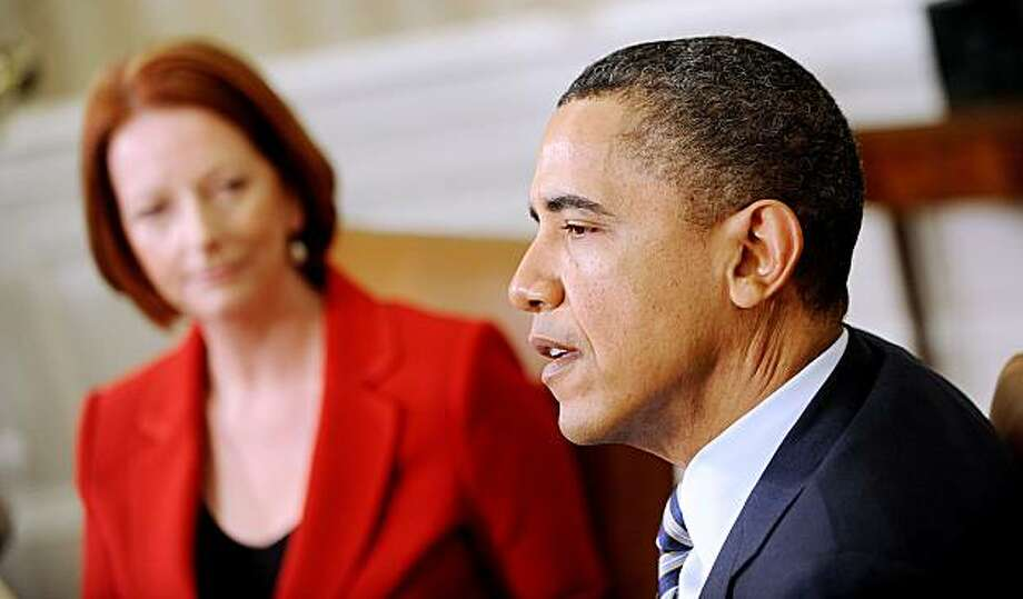 U.S President Barack Obama meets with Julia Gillard, prime minister of Australia, in the Oval Office of the White House in Washington, D.C., U.S., on Monday, March 7, 2011. Obama, said the U.S. and Australia have a shared interest in expanding trade in the Pacific region. Photographer: Olivier Douliery/Pool via Bloomberg *** Local Caption *** Barack Obama; Julia Gillard Photo: Olivier Douliery, Via Bloomberg