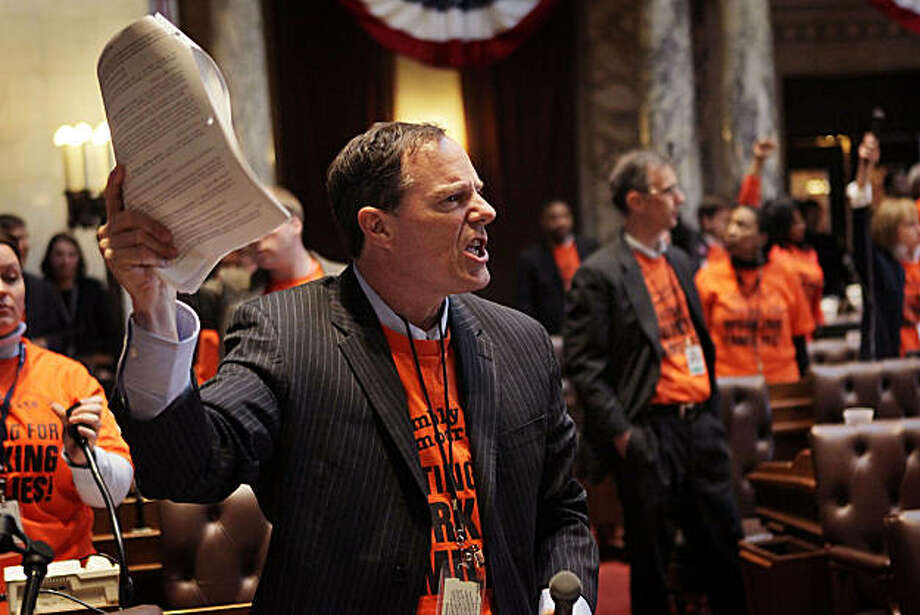 MADISON, WI - MARCH 10:  Jon Richards, 19th Assembly District Democrat and other Democratic lawmakers express outrage following a 53-42 vote which essentially eliminated collective bargaining rights for public union workers except on wage issues on March10, 2011 in Madison, Wisconsin. Thousands of demonstrators took over the Capitol last night following the Senate vote on the bill which passed with no Democrats present. Photo: Scott Olson, Getty Images
