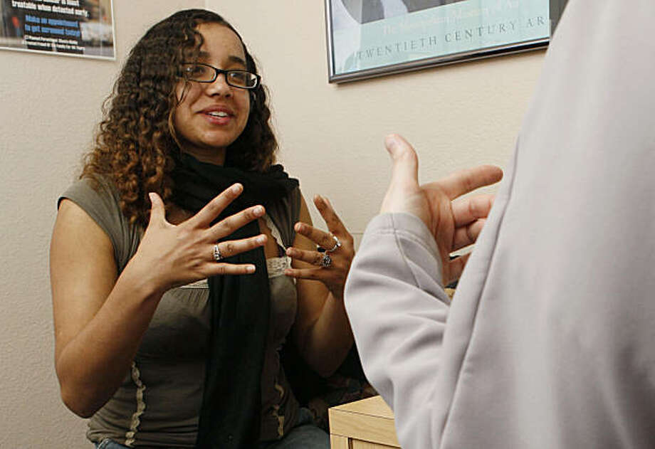 Jasmine Berry discusses her preferred contraception method with a Planned Parenthood employee at their location in Walnut Creek Calif, on Friday, March 11, 2011. Photo: Alex Washburn, The Chronicle