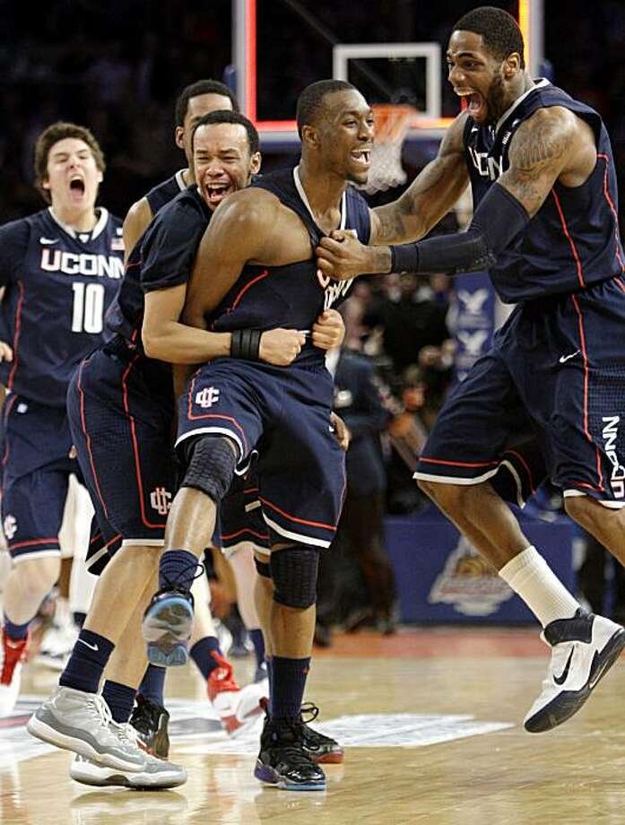 Connecticut's Kemba Walker, center, celebrates scoring the winning goal in the final seconds of the second half of an NCAA college basketball game against Pittsburgh at the Big East Championship, Thursday, March 10, 2011 at Madison Square Garden in New York.  Connecticut defeated Pittsburgh 76-74. Photo: Mary Altaffer, AP