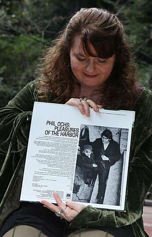 Meegan Lee Ochs, daughter of folksinger Phil Ochs, at home in Woodacre, Calif., showing  the back of an album cover with a picture of her and her dad on Tuesday, March 1, 2011.  She is being interviewed in conjunction with the release of a new film about her father, Phil Ochs: There But For Fortune. Photo: Liz Hafalia, The Chronicle