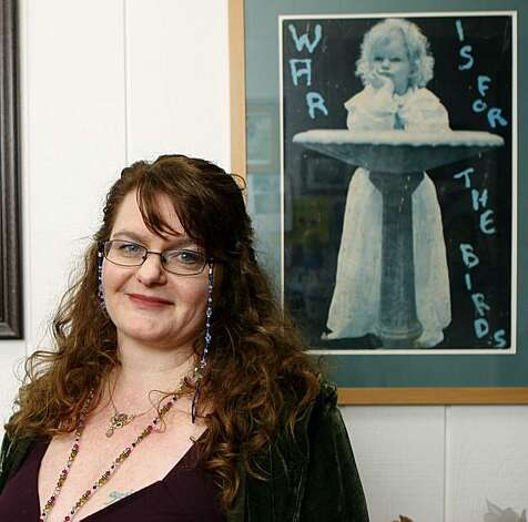 Meegan Lee Ochs, daughter of folksinger Phil Ochs, standing next to a picture of herself taken by her mother at home in Woodacre, Calif., on Tuesday, March 1, 2011.  She is being interviewed in conjunction with the release of a new film about her father, Phil Ochs: There But For Fortune. Photo: Liz Hafalia, The Chronicle