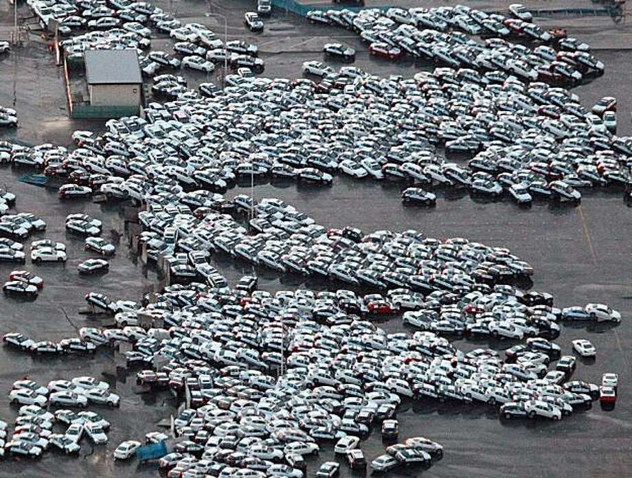 An aerial shot shows vehicles ready for shipping being carried by a tsunami tidal wave at Hitachinaka city in Ibaraki prefecture on March 11, 2011. A massive 8.8-magnitude earthquake shook Japan, unleashing a powerful tsunami that sent ships crashing intothe shore and carried cars through the streets of coastal towns. Photo: Str, AFP/Getty Images