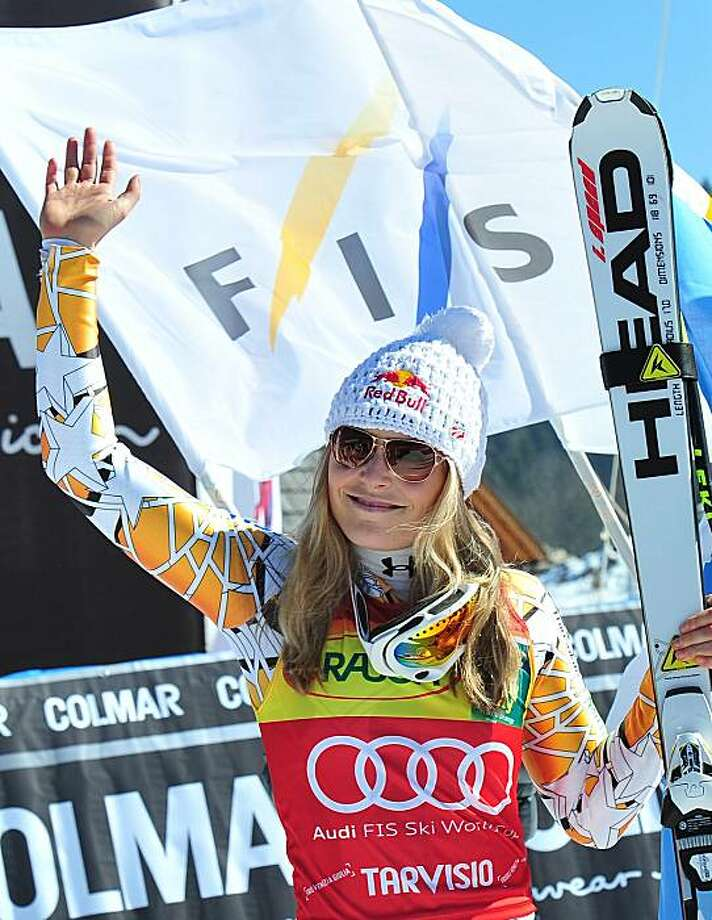 Lindsey Vonn of the United States celebrates after winning an alpine ski, women's World Cup super G, in Tarvisio, Sunday, March 6, 2011. Photo: Armando Trovati, AP