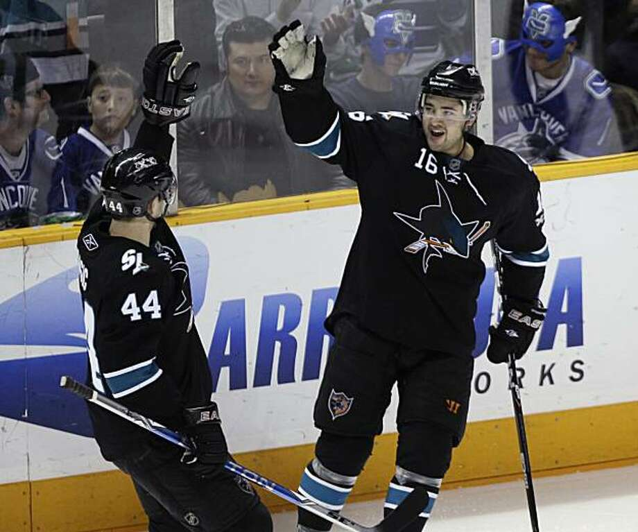 San Jose Sharks right wing Devin Setoguchi (16) is congratulated by defenseman Marc-Edouard Vlasic (44) after scoring against the Vancouver Canucks in the second period of an NHL hockey game in San Jose, Calif., Thursday, March 10, 2011. Photo: Paul Sakuma, AP